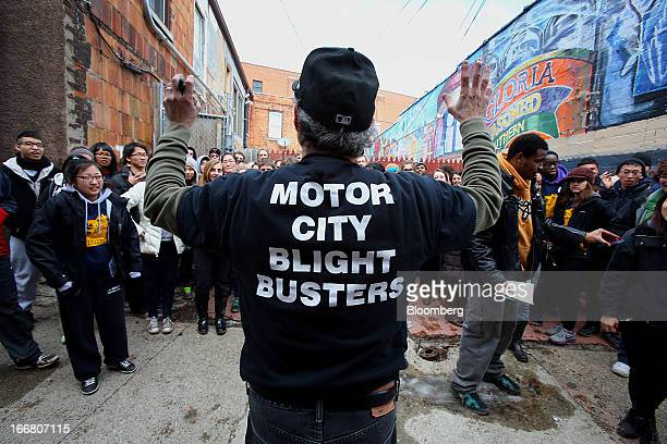 John George founder of Blight Busters directs a group of volunteers helping to clean up a section of Detroit Michigan US on Saturday March 23 2013...