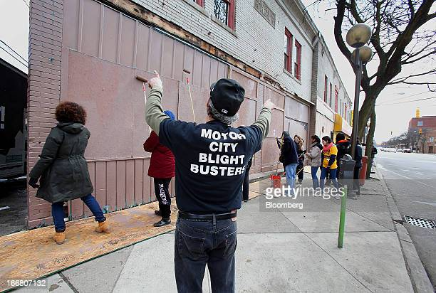 John George founder of Blight Busters directs a group of volunteers clean up a section of Detroit Michigan US on Saturday March 23 2013 Motor City...