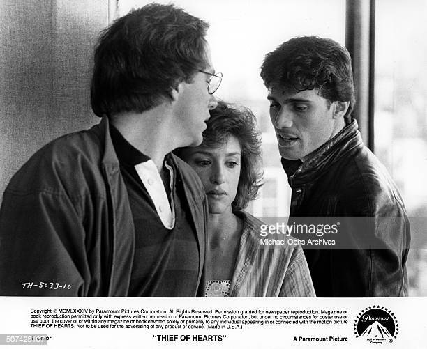 John Getz and Barbara Williams find their marriage disrupted by Steven Bauer in a scene for the Paramount Pictures movie Thief of Hearts circa 1984