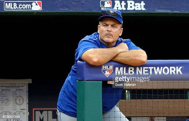 John Gibbons of the Toronto Blue Jays looks on against the Texas Rangers during game one of the American League Divison Series at Globe Life Park in...
