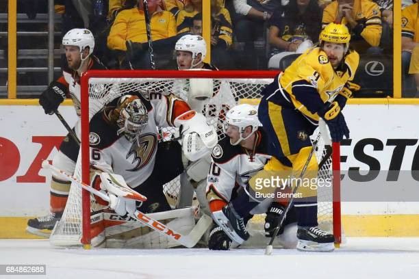 John Gibson and Corey Perry of the Anaheim Ducks get tangled in the goal during the second period against the Nashville Predators in Game Four of the...