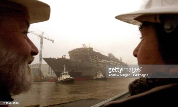 John Gibson and daughter Wendy Gibson from Paisley Scotland watch as the Queen Mary 2 floats for the first time in Saint Alazaire Brittany FranceThe...