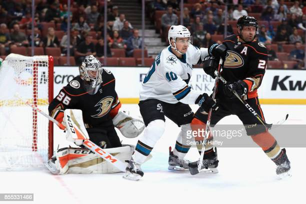 John Gibson and Francois Beauchemin of the Anaheim Ducks defend against Ryan Carpenter of the San Jose Sharks during the second period of a preseason...