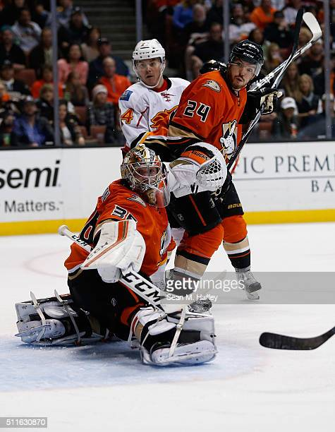 John Gibson and Simon Despres of the Anaheim Ducks defend against a shot as Jiri Hudler of the Calgary Flames looks on during the second period of a...