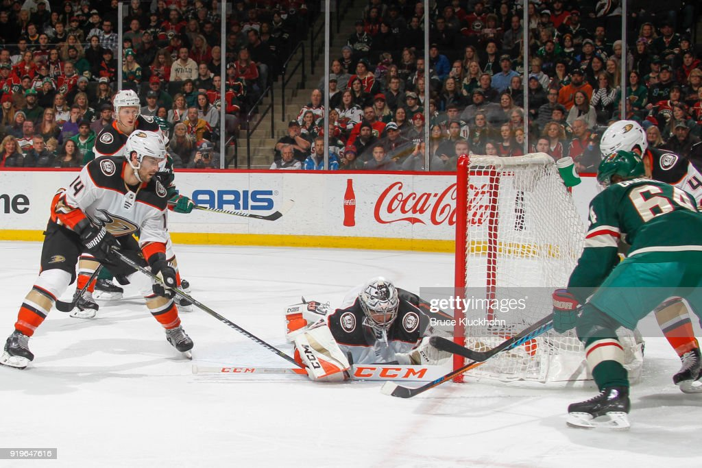 John Gibson #36 makes a save while his teammates Adam Henrique #14 and Cam Fowler #4 of the Anaheim Ducks defend against Mikael Granlund #64 of the Minnesota Wild during the game at the Xcel Energy Center on February 17, 2018 in St. Paul, Minnesota.