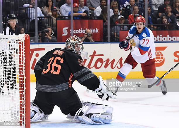 John Gibson of Team North America and Ivan Telegin of Team Russia track a flying puck during the World Cup of Hockey 2016 at Air Canada Centre on...