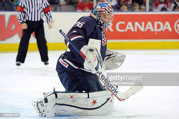 John Gibson of Team USA makes a blocker save on the puck during the 2012 World Junior Hockey Championship game against Team Finland at Rexall Place...