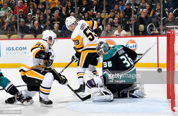 John Gibson of the Anaheim Ducks can't make a save on Evgeni Malkin of the Pittsburgh Penguins at PPG Paints Arena on December 17 2018 in Pittsburgh...