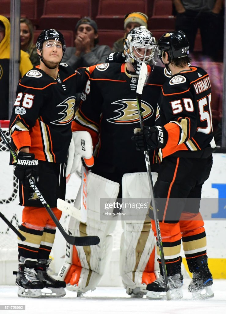 John Gibson #36 of the Anaheim Ducks celebrates a 4-2 win over the Boston Bruins with Antoine Vermette #50 ,playing his 1000th game, and Brandon Montour #26 at Honda Center on November 15, 2017 in Anaheim, California.