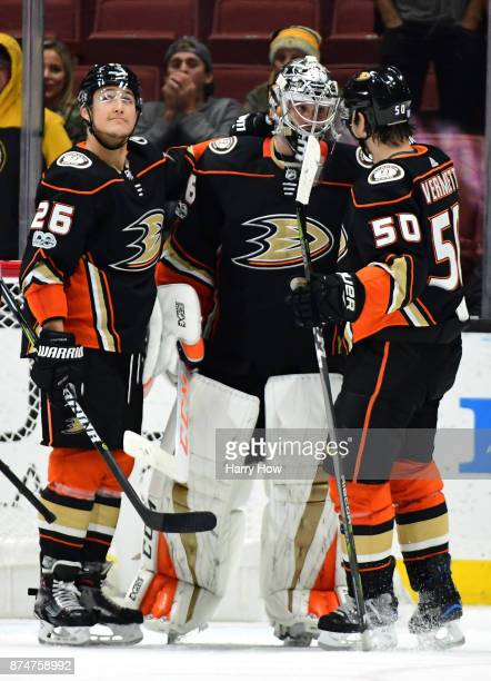 John Gibson of the Anaheim Ducks celebrates a 42 win over the Boston Bruins with Antoine Vermette playing his 1000th game and Brandon Montour at...