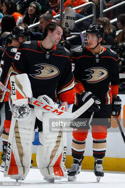 John Gibson of the Anaheim Ducks chats with Brandon Montour in Game Two of the Western Conference First Round against the San Jose Sharks during the...