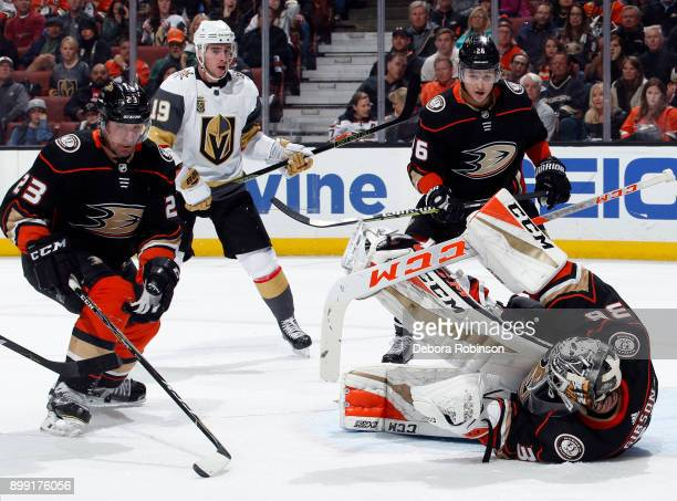 John Gibson of the Anaheim Ducks goes on his side to stop a puck with Francois Beauchemin and Brandon Montour looking on with Reilly Smith of the...