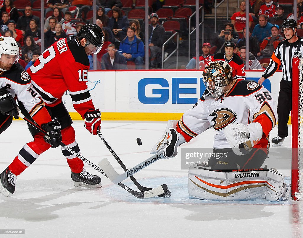 John Gibson #36 of the Anaheim Ducks makes a save against Steve Bernier #18 of the New Jersey Devils during the game at the Prudential Center on March 29, 2015 in Newark, New Jersey.