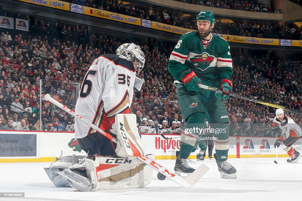 John Gibson #36 of the Anaheim Ducks makes a save with Daniel Winnik #26 of the Minnesota Wild awaiting a rebound during the game at the Xcel Energy Center on February 17, 2018 in St. Paul, Minnesota.