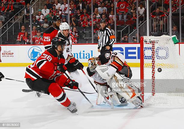 John Gibson of the Anaheim Ducks makes a second period save on Vernon Fiddler of the New Jersey Devils at the Prudential Center on October 18 2016 in...