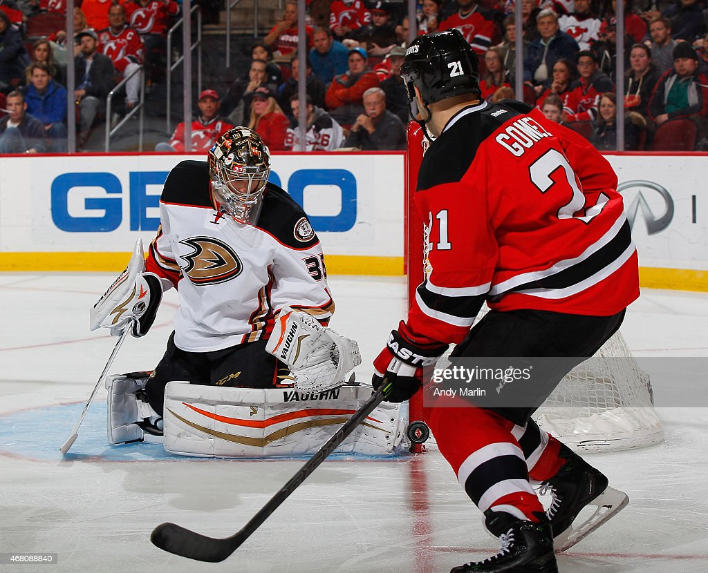 John Gibson #36 of the Anaheim Ducks makes a skate save as Scott Gomez #21 of the New Jersey Devils looks for a rebound during the game at the Prudential Center on March 29, 2015 in Newark, New Jersey.