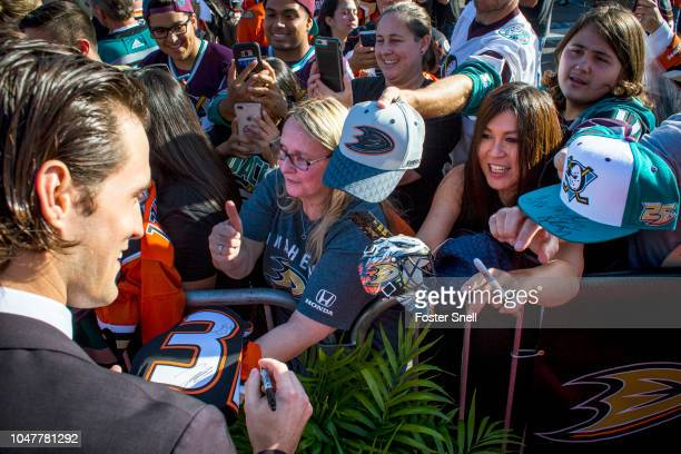 John Gibson of the Anaheim Ducks signs autographs prior opening night against the Detroit Red Wings on October 8 2018 at Honda Center in Anaheim...