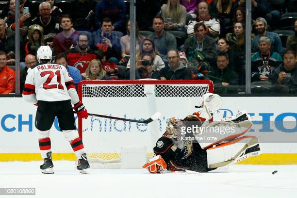 John Gibson of the Anaheim Ducks slides for the save on a shot from Kyle Palmieri of the New Jersey Devils during a shoot out at Honda Center on...