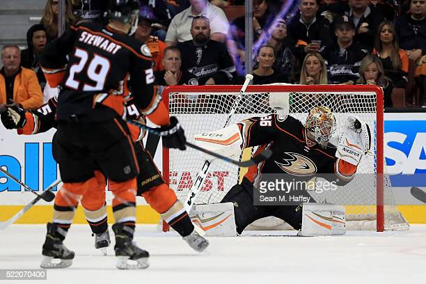 John Gibson of the the Anaheim Ducks gloves a save during the first period in Game Two of the Western Conference Quarterfinals against the Nashville...
