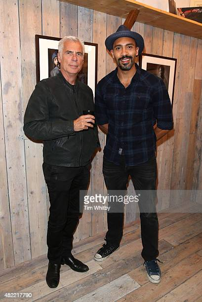 John Giddings and Alex Lanipekun attend a private view of FH Faces a series of portraits by photographer Gary Wallis presented by Flying Horse Indigo...