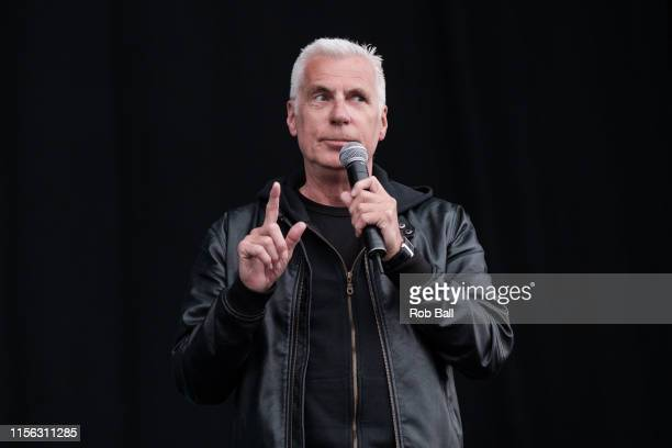 John Giddings comes on stage to announce Jess Glynne has cancelled her set at Isle of Wight Festival 2019 at Seaclose Park on June 16 2019 in Newport...