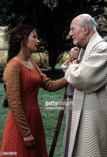 John Gielgud grabbing onto Julia Ormond's hand in a scene from the film 'First Knight', 1995.