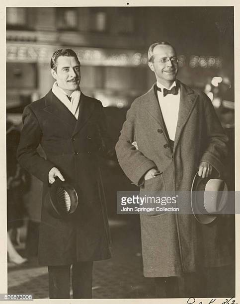 John Gilbert and Donald Ogden Stewart enter Grauman's Chinese Theater for the Los Angeles premier of The Merry Widow a MetroGoldwynMayer picture