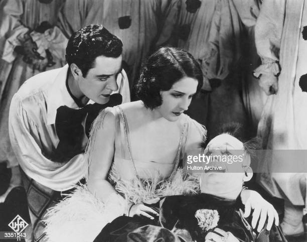 John Gilbert and Norma Shearer comfort the dying Lon Chaney in a tragic scene from the film 'He Who Gets Slapped' The movie was directed by Victor...