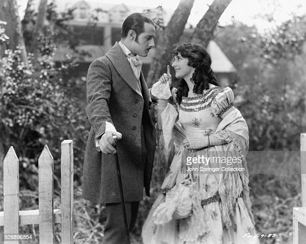 John Gilbert as Cameo Kirby and Gertrude Olmstead as Adele Randall in the silent drama film 'Cameo Kirby' directed by John Ford 1923