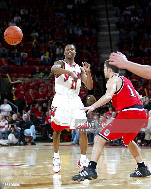 John Gilchrist of the University of Maryland slings a long pass past Egin Atsur of North Carolina State at Comcast Center in College Park Maryland on...