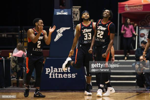 John Gillon Jeremy Hollowell and Jeremy Evans of the Erie BayHawks react to a play against the Canton Charge on March 11 2018 at Canton Memorial...