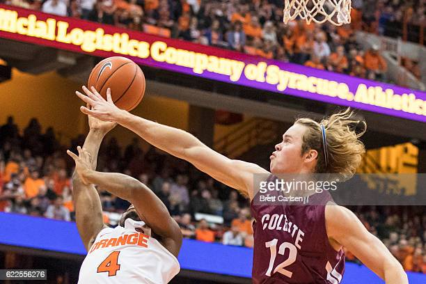 John Gillon of the Syracuse Orange is fouled by Dana Batt of the Colgate Raiders while going up for a ball during the second half on November 11 2016...