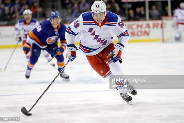 John Gilmour of the New York Rangers chases the puck in the first period against the New York Islanders during their game at Barclays Center on...