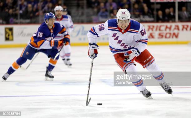 John Gilmour of the New York Rangers skates with the puck in the first period against the New York Islanders during their game at Barclays Center on...