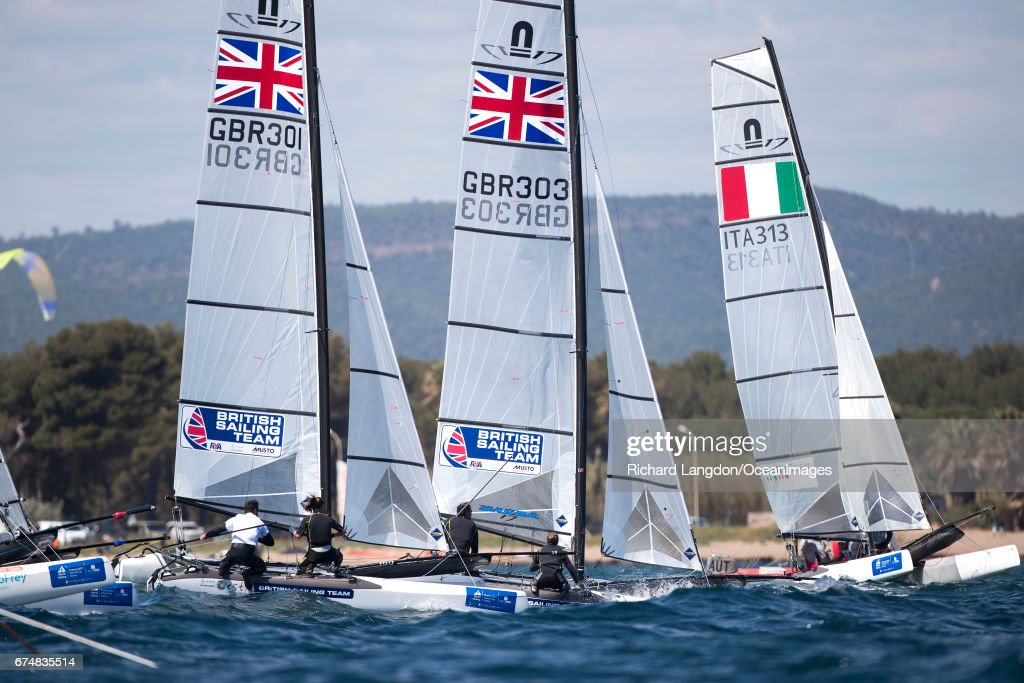John Gimson and Anna Burnet (left) and Tom Phipps and Nikki Boniface (centre) from the British Sailing Team sail their Nacra 17s during the ISAF Sailing World Cup Hyeres on APRIL 29, 2017 in Hyeres, France.