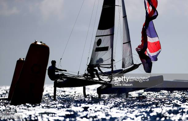 John Gimson and Anna Burnet of Team Great Britain compete in the Nacra 17 Foiling class on day eleven of the Tokyo 2020 Olympic Games at Enoshima...