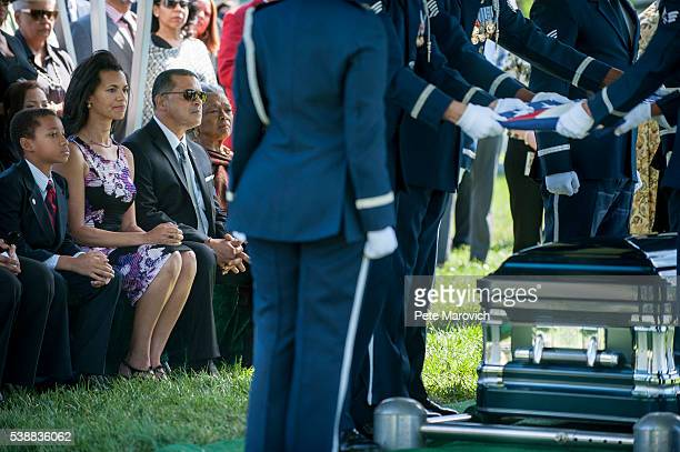 John Glenn Jr daughter Fredricka Whitfield son Lonnie Whitfield and wife Nola Whitfield look on as an Air Force Honor Guard folds the flag that...