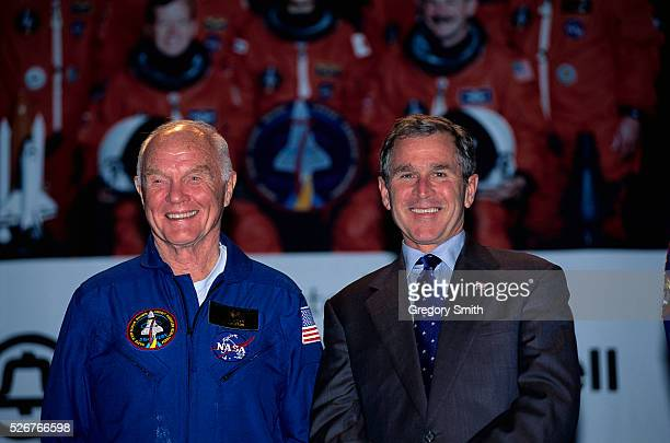 John Glenn stands beside Texas Governor George W Bush during a ceremony following Glenn's shuttle mission