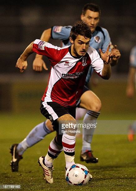 John Goddard of Woking breaks clear from Lee Burns of Darford during the Skrill Conference Premier League match between Woking and Dartford at the...