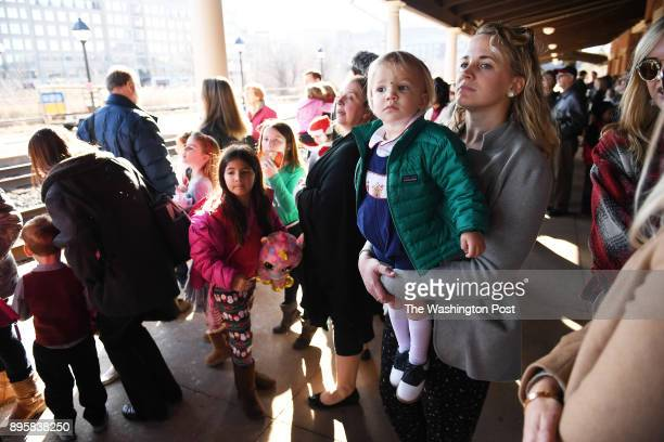 John Golden and his mother Leslie Golden wait to board the Santa Railway Express at Alexandria Union Station on Monday December 18 2017 in Alexandria...