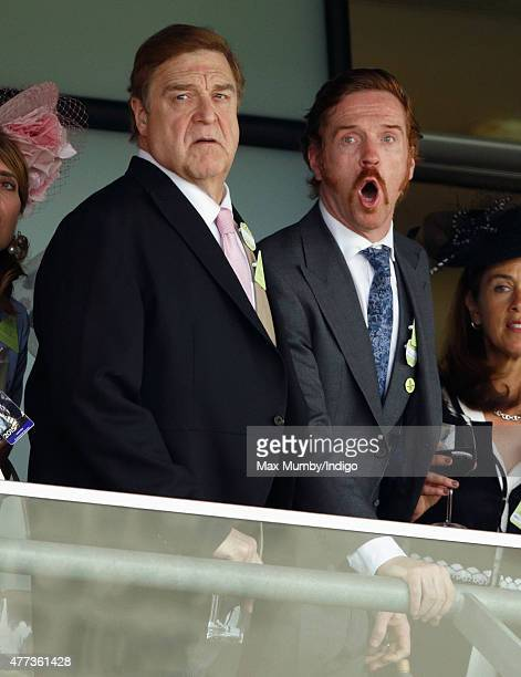 John Goodman and Damian Lewis watch the racing as they attend day 1 of Royal Ascot at Ascot Racecourse on June 16 2015 in Ascot England