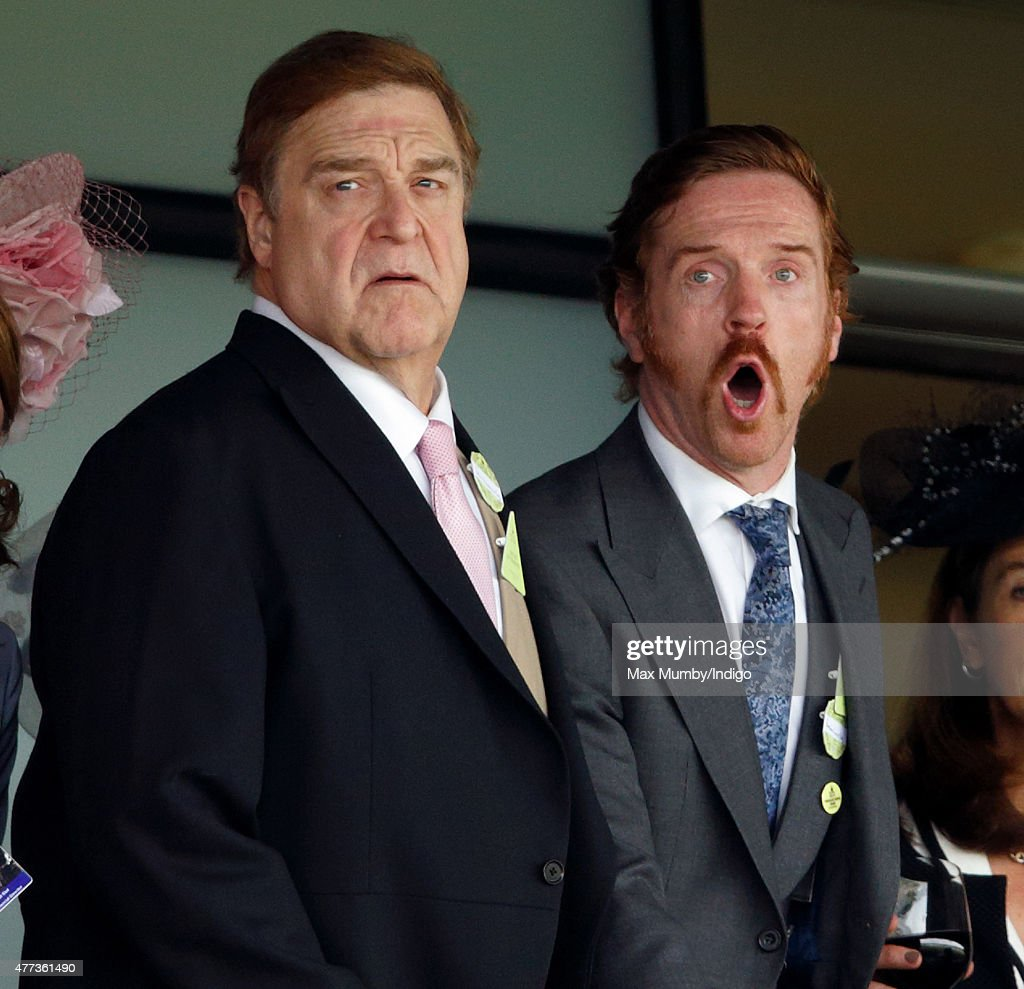 John Goodman and Damian Lewis watch the racing as they attend day 1 of Royal Ascot at Ascot Racecourse on June 16, 2015 in Ascot, England.