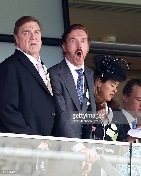 John Goodman and Damien Lewis cheer on the horses on day 1 of Royal Ascot at Ascot Racecourse on June 16 2015 in Ascot England