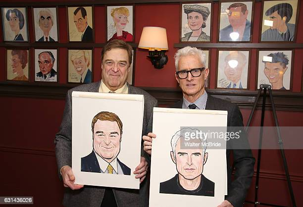 John Goodman and John Slattery pose with their newly unveiled caricatures at Sardi's on January 10, 2017 in New York City.