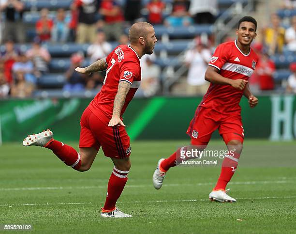 John Goossens of Chicago Fire celebrates a goal against Orlando City FC with teammate Brandon Vincent during an MLS match at Toyota Park on August 14...