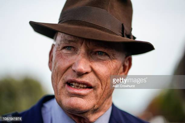 John Gosden poses at Newmarket Racecourse on October 13 2018 in Newmarket United Kingdom