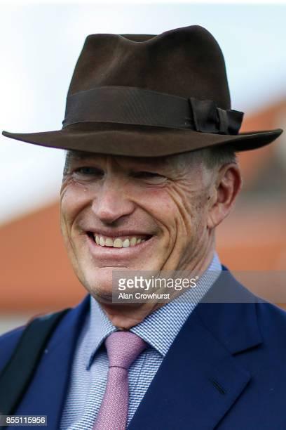 John Gosden poses at Newmarket racecourse on September 28 2017 in Newmarket United Kingdom