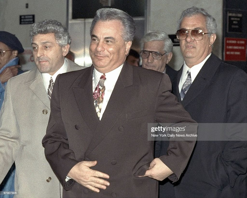John Gotti and older brother Peter (right) leave Manhattan Supreme Court where he is on trial on charges of conspiracy and assault in the 1986 shooting of a carpenter's union offical.