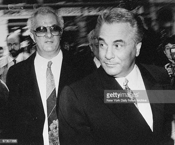 John Gotti arrives at Manhattan Supreme Court where he is on trial on charges of conspiracy and assault along with older brother Peter The jury...