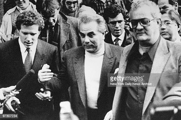 John Gotti is surrounded by reporters as he leaves courthouse with his brother Peter